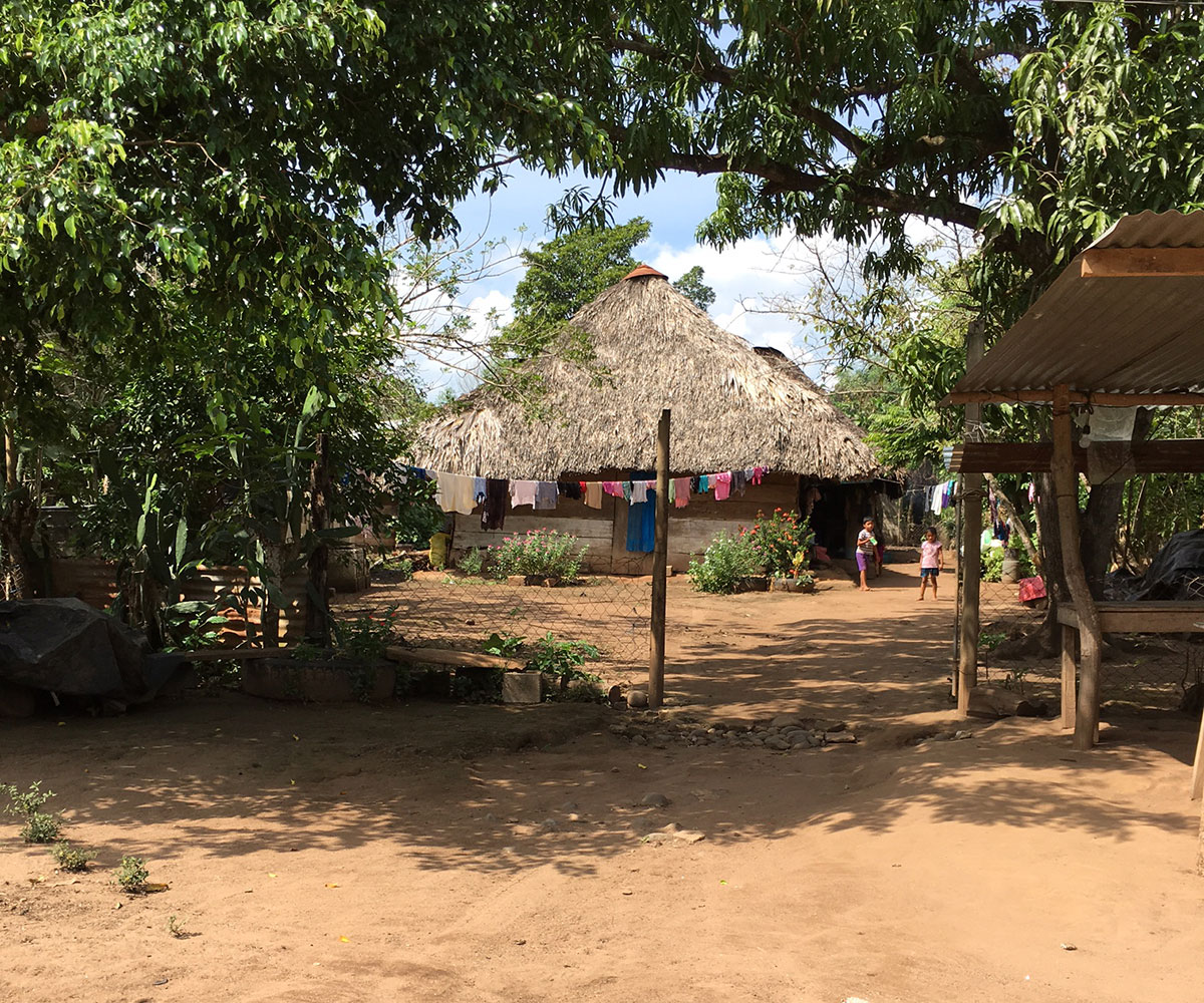 The entrance to a Guatemalan village with a hut in the background