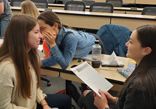 "Students take part in a ""hearing voices"" activity that one instructor said many people find ""unsettling"" and ""eye-opening."""