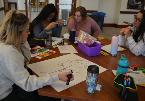 Activities are a large part of the MHFA training. Here, students illustrate signs and symptoms of anxiety.